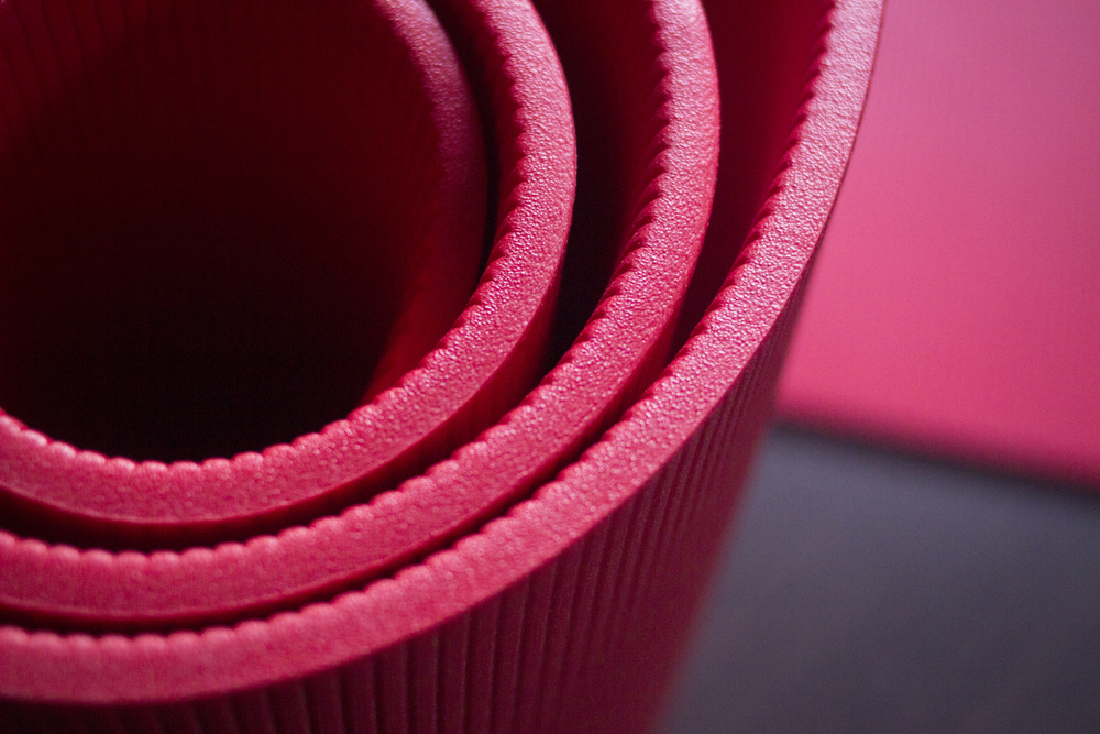 curled-red-pilates-fitness-mats (346031219)